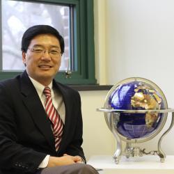 Dan Sui with globe