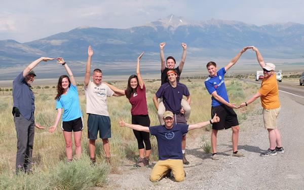 Students doing OHIO pose in the field